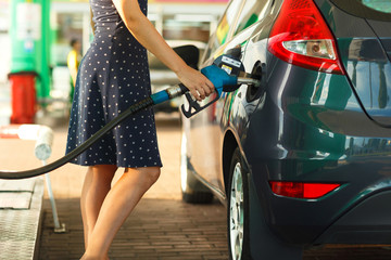 Woman fills petrol into her car