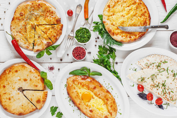 Bakery products - georgian national cuisine. Hachapuri, cheburek lavash, meat pies, served on white background