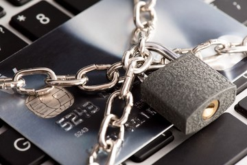 Close up view of a secure credit card on computer keyboard