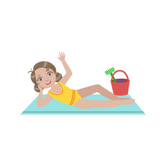 Girl On Beach Blanket With Plastic Bucket Of Toys