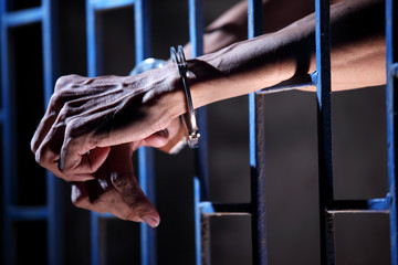 hands of prisoner in jail