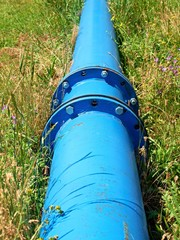 Repaired  water pipes with blue flanges and screws