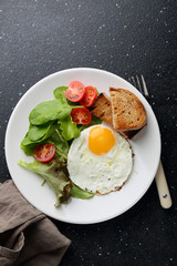 Breakfast egg with salad