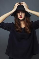 Model girl in felt hat