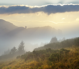 Autumn landscape with fog in the mountains