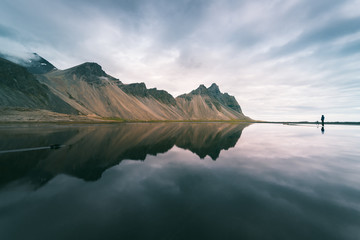 Landscape with mountains reflected in water, Iceland