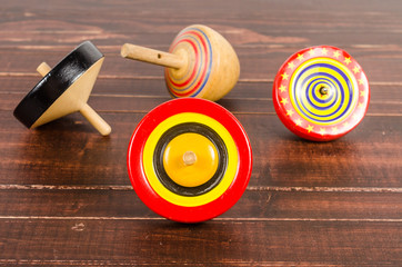 Old colorful wooden spinning top toy