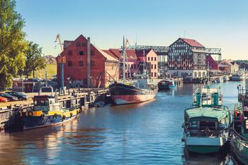 Obraz Ships and boats on Dane river in Klaipeda, Lithuania. - fototapety do salonu
