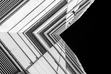 Urban Geometry, looking up to building. Modern architecture black and white, concrete and glass.  Abstract architectural design. Inspirational Artistic image and point of view.