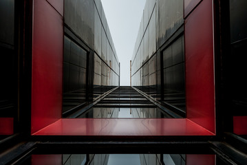 Urban Geometry, looking up to glass building. Modern architecture, glass and steel. Abstract architectural design. Inspirational, artistic image. Industrial design. .Modern building.