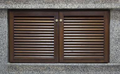 Wooden door and window shutter with louvers for background textu
