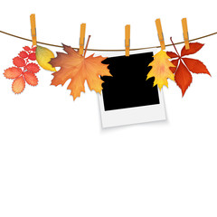 Photo frame on rope with clothespins and autumn leaves vector
