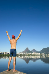 Athlete swimmer standing in front of the Rio de Janeiro skyline at Lagoa Rodrigo de Freitas lagoon