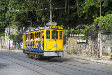 Iconic bonde tram travels along the streets of the tourist nieghborhood of Santa Teresa in Rio de Janeiro, Brazil