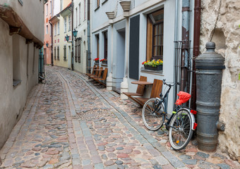 Narrow medieval street in old Riga that is the capital of Latvia and famous Baltic city known of its medieval architecture.