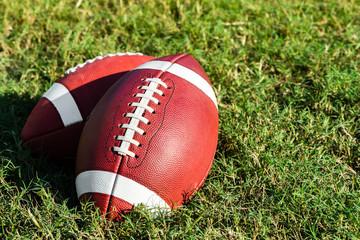 Two American College High School Junior Football on Grass
