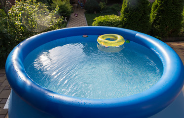 Outdoor blue inflatable pool with water