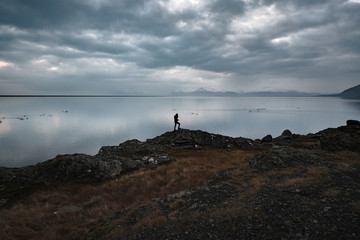 Man walking in a landscape in Iceland