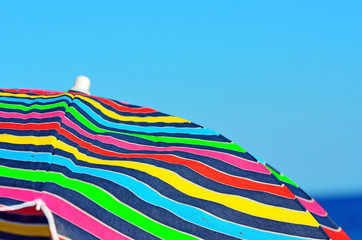 colorful umbrella in the sky of Bergeggi Savona Italy