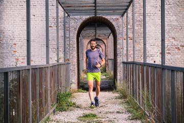 Wall Mural - Man running on a bridge