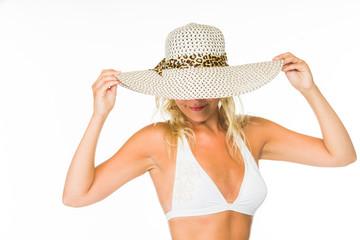 Woman posing in a white bikini over white
