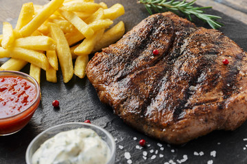 Deurstickers Steakhouse Beef steak with french fries and sauce