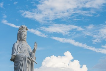 The beautiful statue of Guanyin with blue sky and copy space. - Chinese goddess statue (a public temple , can take picture )