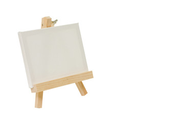 Blank canvas on easel for painting.