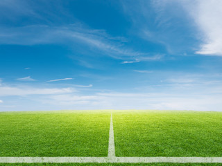 empty soccer field with blue sky background