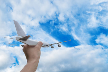 Airplane on hand white background on blue sky cloud