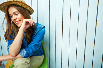 Lifestyle portrait of young woman sitting
