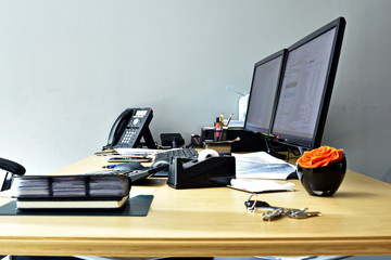 busy office desk with all items at the work