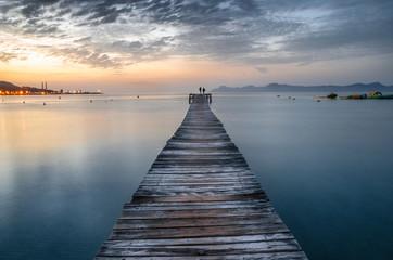 Majorca Puerto de Alcudia beach pier at sunrise in Alcudia bay in Mallorca Balearic islands of Spain