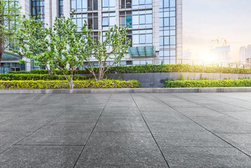 pavement front of financial building with green Wall mural