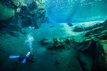 Scuba diving at the divespot Silfra in Iceland Wall mural