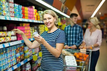 Customer choosing yoghurts