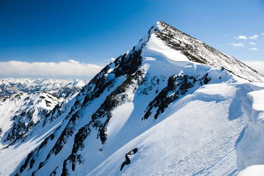 Mountain peak with snowcaps in winter.