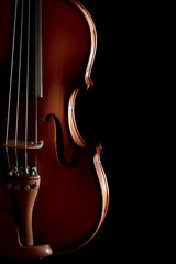 Close up of a violin isolated on black background