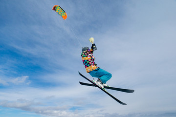 Sportsman is kiting in the air with a cup in his arms on the background of blue sky at sunny day