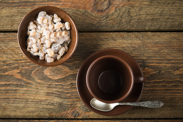 coffee cups, beans and sugar on rustic wooden table background