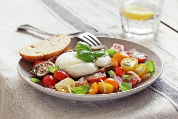 Italian Caprese salad with tomatoes,mozzarella and basil.Selective focus