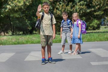 cute little school children students crossing street walking thr