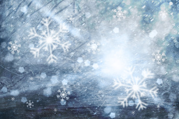 Abstract winter season illustration background with snowflakes and light beams. Lovely blue colored Christmas and New Year Holiday greeting card with copy space background.