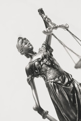 Symbol of justice statue on the white background. Black and white image