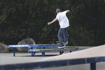 Skateboarder Grinding Ledge
