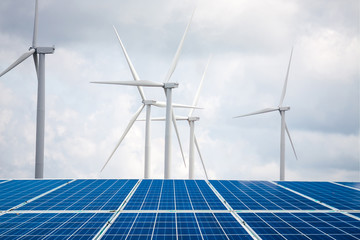 solar panels and wind turbines with the clouds and sky