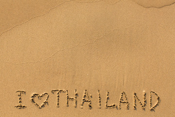 I Love Thailand - manually inscription on wet sea beach sand.