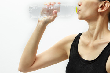 Beautiful fitness athlete woman drinking water on white backgrou