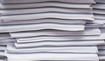 A stack of papers on desk