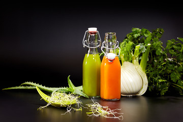 Glasses with fresh vegetable juices isolated on black. Detox die